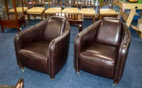 A Pair of Superb Quality Contemporary Leather Tub Chairs in aviator brown and with turned wood