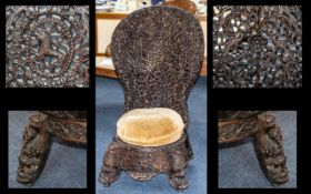 19thC Profusely Carved Burmese Hardwood Low Chair The spoon shaped back profusely carved with
