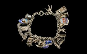 A Vintage Sterling Silver Charm Bracelet loaded with 20 silver charms.