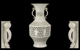 Chinese Blanc-de-Chine Reticulated Vase finely potted and with detailed decorations depicting