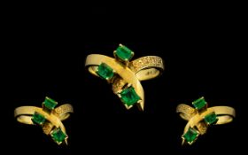 18ct Gold - Attractive 3 Stone Emerald Set Ring of Contemporary Design. The Columbian Emeralds of