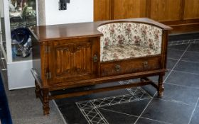 Oak Hall Table & Seat with a cupboard and upholstered seat with a drawer beneath.