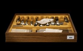 A Canteen of Community Plate Cutlery an 8 piece setting housed in a teak effect box.