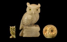 Collection of Three Owl Figures comprising an Onyx owl figure raised on a base with glass eyes,