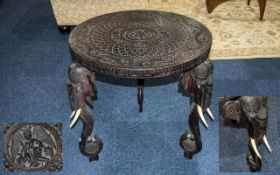 Indian Carved Round Teak Centre Table with carved top of typical form,