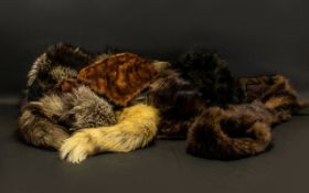 Collection of Vintage Fur Stoles and Scarves to include two long Mink scarves; a golden fur scarf;