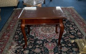 Side/Coffee Table in polished mahogany style, raised on four cabriole legs with claw feet,