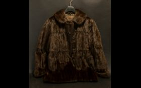 Ladies Dark Brown Mink Jacket fully lined in printed sateen. Hook and eye fastening, with collar and