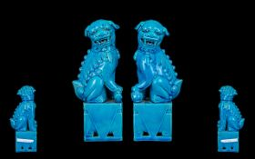 Chinese Turquoise Glazed Pair of Temple Dogs, seated on bases (Republic period) unglazed bases.