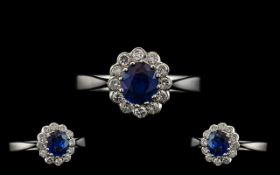 18ct White Gold 1950's Sapphire and Diamond Set Cluster Ring the central faceted sapphire of