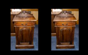 A Matched Pair of Mahogany Bedside Cabinets with a drawer with brass drop handles and a shaped