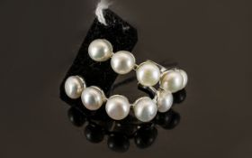 White Fresh Water Pearl J-Hoop Earrings, each earring having five natural white,
