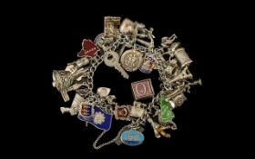 A Vintage Nice Quality Sterling Silver Curb Bracelet loaded with over 36 charms.