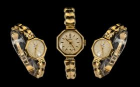Rolex Tudor Ladies Mechanical Hand Wind 9ct Gold Octagonal Shaped Cased Wrist Watch.