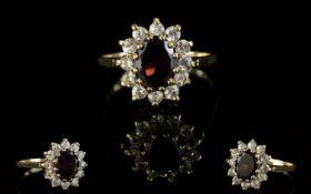 A Vintage 9ct Gold Attractive Garnet And CZ Set Cluster Ring. Flower head design.