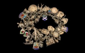 1970's Sterling Silver Charm Bracelet loaded with over 40 sterling silver charms.