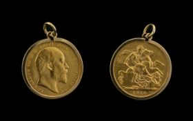 Edward VII 22ct Gold Full Sovereign date 1910 London Mint with 9ct gold mount 9.2 grams.