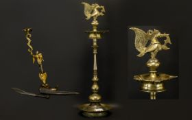 Indian Brass Temple Oil Burner - with a bird finial, 22 inches high.