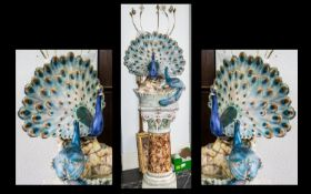 Large Peacock Water Feature with ornate pedestal base holding a water feature adorned with a