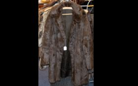 Ladies Dark Brown Mink Coat with collar and reveres, two side slit pockets,