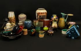 Collection of Vintage Pottery Items to include vases, jugs, Poole pottery dolphin, pots, plates,