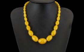 Amber Egg Yolk Coloured Graduated Glass Beads circa 1930's. 16 inches in length with screw clasp.
