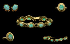 A Continental Suite Of 14ct Gold Opal Set Jewellery To Include A Bracelet Consisting Of Nine Oval