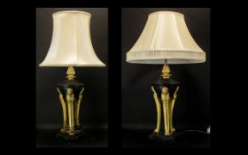 A Pair of Elegant Brass Lamps in the French Regency taste with three carriers holding the font in a
