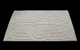 Cream Wool Jeff Banks Designer Rug measures approx 36'' x 60''. Cream with embossed pattern.