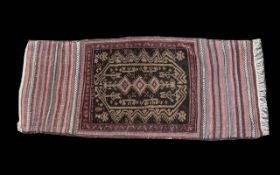 A Turkish Woven Wool Carpet burgundy and brown ground and traditional Middle Eastern red border