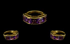 Amethyst Large Band Ring, comprising five square cut Royal purple amethysts totalling 8.