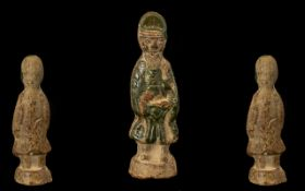 Early Ming Period Tomb Potter Figure of an official, decorated with a green splash glaze. Height 6.