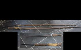 Zulu Throwing Spears, two large wooden s