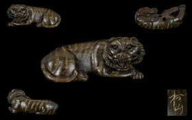 A Japanese Carved Boxwood Netsuke In The Form Of A Tiger. Finely Carved - Signed To Base.