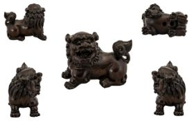 Japanese 19th Century Fine Quality Hand Carved Boxwood Netsuke - Depicts a Temple Dog.