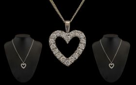 18ct White Gold Impressive Diamond Set Heart Shaped Pendant with attached 18 ct white gold chain.