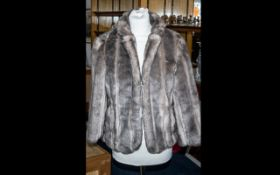 Ladies Faux Fur Jacket hip length, hook and eye fastening, faux mink in taupe brown colour.
