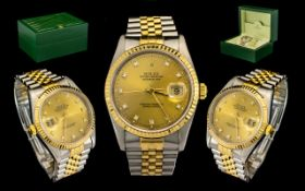 Rolex Oyster 18ct Gold and Steel Perpetual Datejust Gents Wrist Watch features a champagne dial,