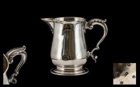 George IIII -Good Quality Sterling Silver Tankard/ Jug of pleasing proportions. Features, Scroll