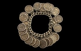 Silver Curb Bracelet Loaded with Over 20 United Kingdom Sixpences, Dating from the 1930's - 1960's,