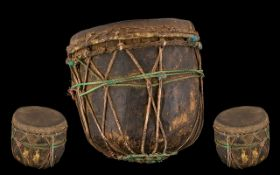 Tribal Antique Wood Drum hewn form a tree trunk with a skin applied. Decorated in string cords. 10