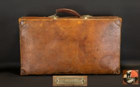 Early 20th Century Leather Suitcase. Superior Leather suitcase, made by Revelation, has the
