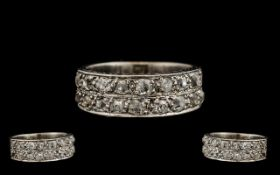 18ct White Gold Attractive Channel Set Diamond Ring - From the 1930's.Set with 20 old round
