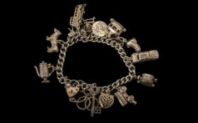 Sterling Silver Good Quality Charm Bracelet - loaded with 15 silver charms. Some notable ones.