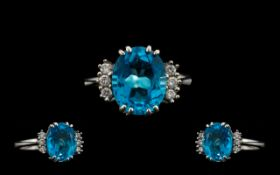 18ct White Gold - Superb Quality and Attractive Blue Topaz and Diamond Set Dress Ring. The Oval