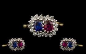 18ct Two Tone Gold Ruby Blue Sapphire and Diamond Set Dress Ring of pleasing design. The ruby and