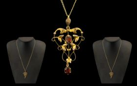 Edwardian Period 9ct Gold Garnet Set Open-worked Pendant with Attached 9ct Gold Chain.