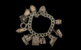Sterling Silver Charm Bracelet Loaded with 10 Good Quality Charms.