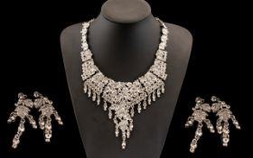 White Crystal Necklace and Earrings Set, the necklace formed from articulated panels with a