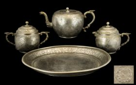 A Chinese Kuthing Swatow Pewter Tea Service, comprising teapot, two handled sugar bowl,